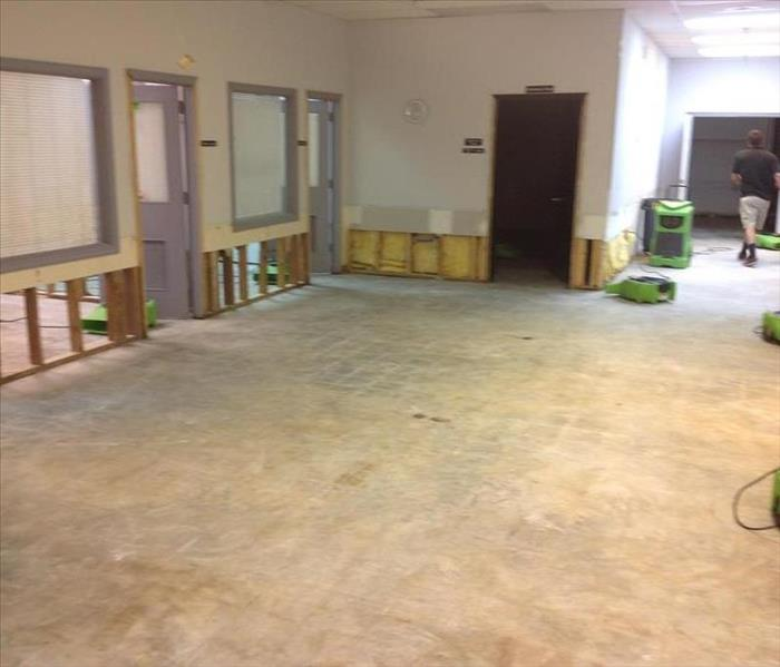 Empty office space after SERVPRO completed the demo of the strom damage - Let the drying begin