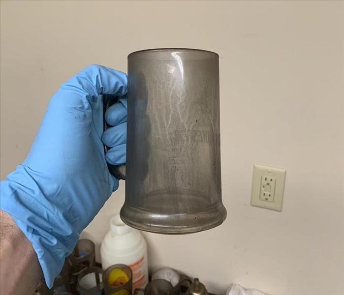 Glassware covered in Soot Residue after a house fire