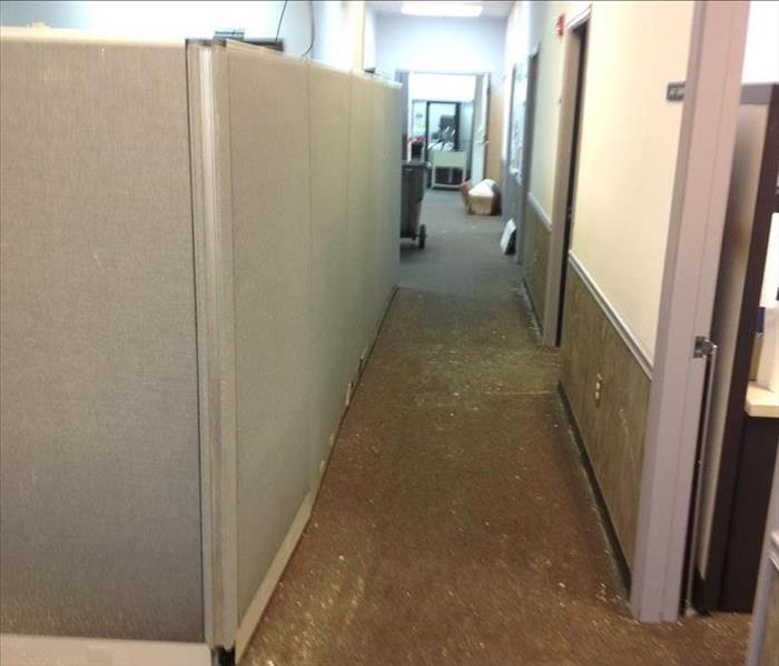 Water damage to flooring and walls due to a storm at a business in Newberry, SC
