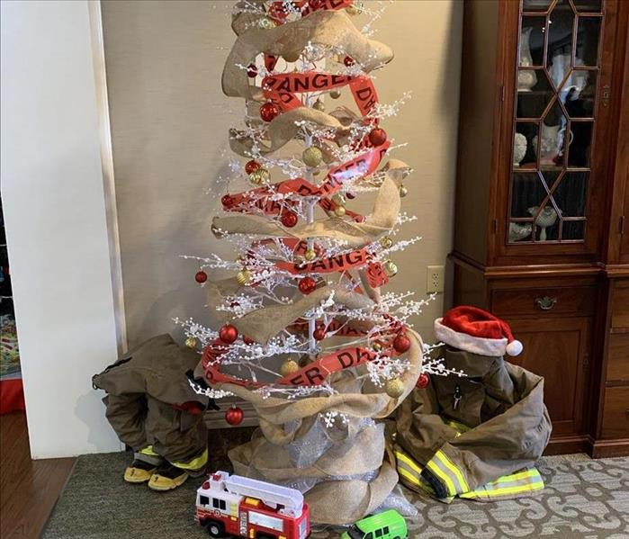 "SERVPRO's ""Not All Heros Wear Capes"" tree decorations competed for the Festival of Tress at Woodbridge of Clinton. SC"