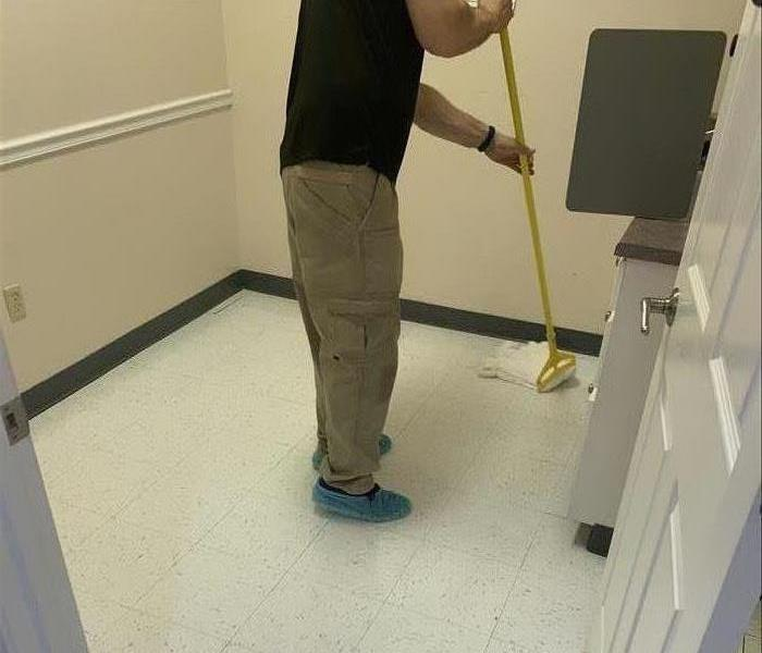 SERVPRO technician cleaning the floors in an office in Clinton, SC