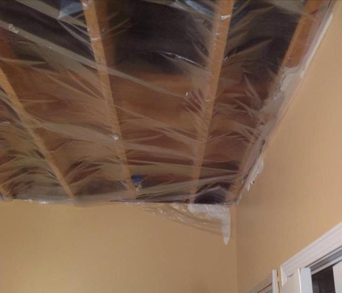 Ceiling removal after a faulty hot water heater in the attic