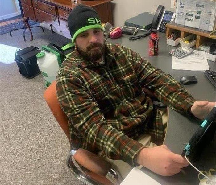 Our SERVPRO technician online completing training for the company, image of male employee at desk