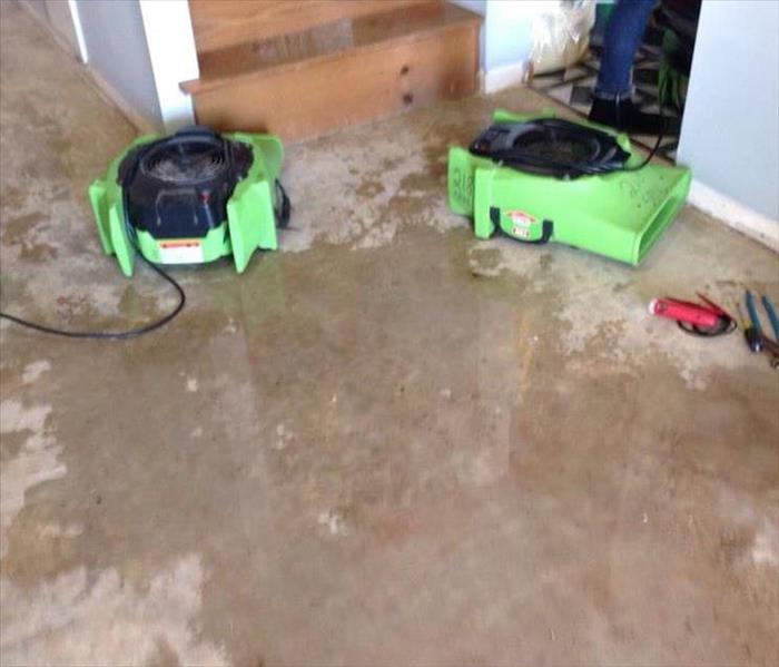 SERVPRO dryers working hard to remove the water damage caused from a busted water line from the water heater in their home.