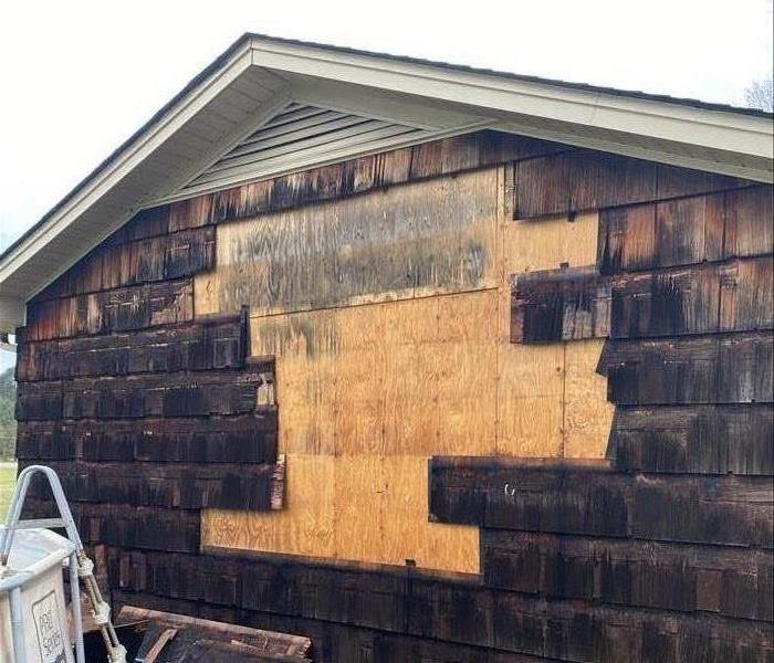 Damaged siding from a thunderstorm that hit Laurens, SC