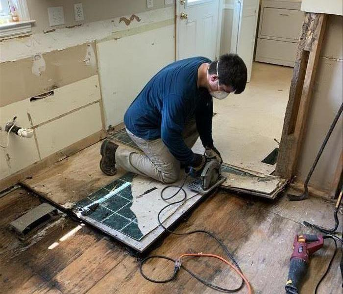 SERVPRO technician working on a demo of the kitchen at a home in Newberry, SC