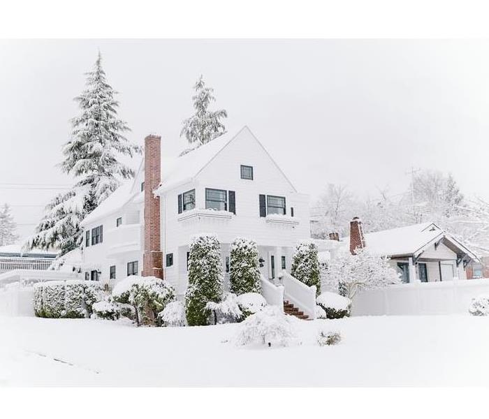 House covered in Snow after a Winter Storm